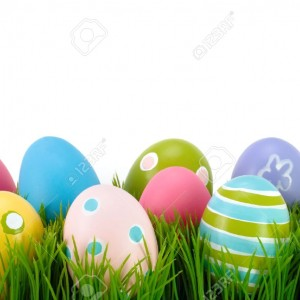 12567964-Easter-colored-eggs-on-the-green-grass--Stock-Photo-egg